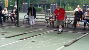 Resident at Glen Arden retirement community playing shuffle board