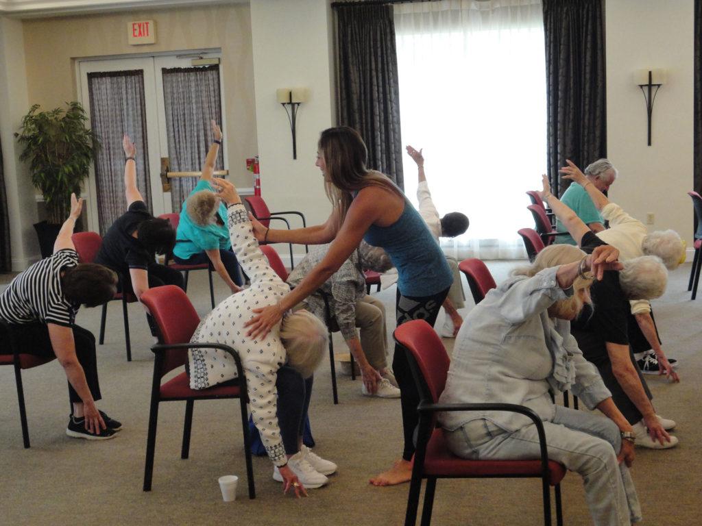 Sulekha adjusting senior exercising