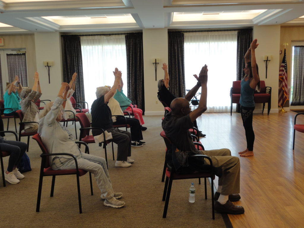 Seniors at Orange County Continuing Care Retirement Community Glen Arden exercising at National Health and Fitness Day